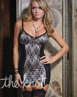 Black lace over nude satin chemise features floral lace print trim, padded bra top, power net side panels, lace-up back detail and adjustable shoulder and garter straps. Stockings not included.