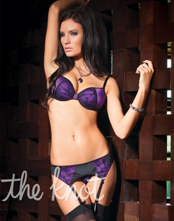 Black floral print lace over royal purple Lycra set features under wire push-up bra with molded padding, adjustable straps, matching lace over Lycra garter belt with adjustable straps and g-string panty. Stockings not included.