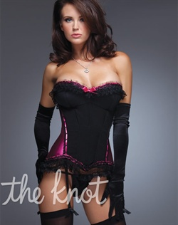 Black and hot pink satin bustier features padded cups, ruffle lace trim detail, hook and eye back, delicate boning, lace and ribbon trim, center front satin bow and detachable and adjustable shoulder and garter straps. Stockings, gloves and thong not included.