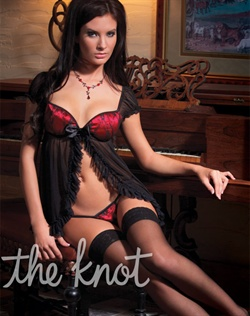 Set features mini black mesh, open front babydoll with cap sleeves, ruffle mesh hem, red satin padded cups with black lace overlay, detachable black satin bow front detail and lace over satin g-string panty.