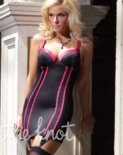 Black Lycra chemise features contrasting hot pink satin piping detail, hot pink trim and straps, under wire molded cups, and adjustable shoulder and garter straps. Stockings not included.