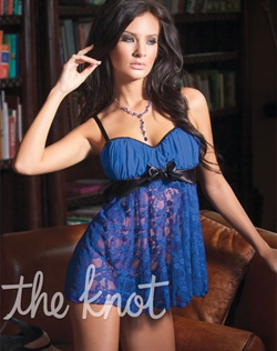 Royal blue babydoll features flowing lace bodice, gathered mesh padded cups, black satin band with detachable satin bow front detail, adjustable straps and matching g-string panty.