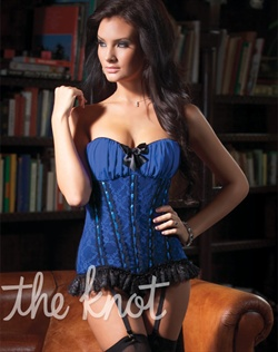 Royal blue lace corset features gathered mesh padded cups, ribbon and lace boning detail, ruffled lace hem, stretch waist with center back hook and eye closure, detachable black satin bow front, and detachable and adjustable shoulder and garter straps. Includes corset only.