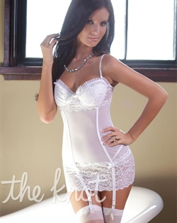 Lace and mesh chemise features gathered mesh, padded under wire cups, front rhinestone bow detail, back hook and eye closure, attached garters and adjustable straps. Stockings and panty not included.