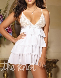 White chemise features satin ribbon and bow, tiered chiffon and fully adjustable straps. Available in sizes S-XL.