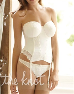 Ivory bustier features boning, underwire, matching adjustable bra and garter straps and 3 column, 9 row hook-and-eye back closure. Available in band sizes 30-38 and UK cup sizes DD-H.