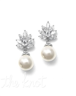 Rhodium-plated silver earrings feature marquise cubic zirconias and large faux pearl drop.