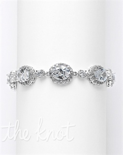Rhodium-plated bracelet features oval cubic zirconias with pave cubic zirconia borders. 7&quot; L