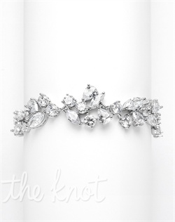"Rhodium-plated silver bracelet features vine-like cubic zirconias. 7"" L"
