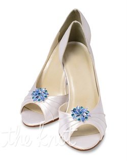 Detachable shoe clip flowers feature rhinestones and crystals. Available in crystal, clear, pink, green or purple.