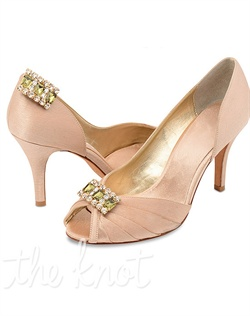 Detachable shoe clips feature rhinestones. Available in green, blue, black, amber or pink.