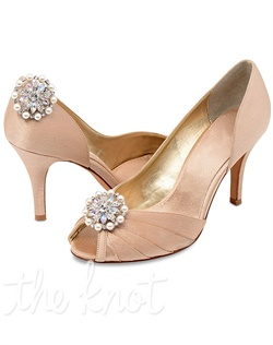 Detachable shoe clips feature pearls and rhinestones.