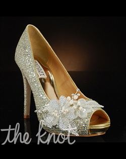 Gold shoe features decoration at toe.