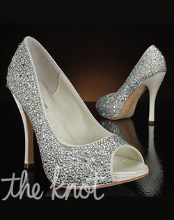 Rhinestone studded pump features peep-toe and covered platform.