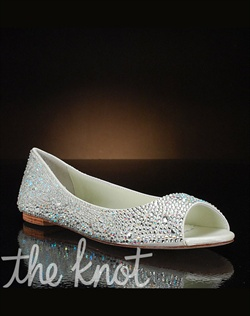Sparkly flat features peep-toe.