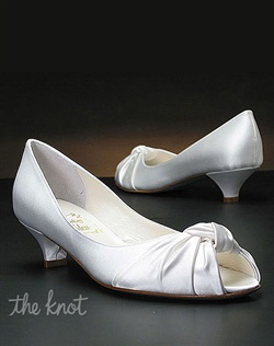 "Dyeable white silk satin 1 1/2"" heel pump with knot detail at toe."