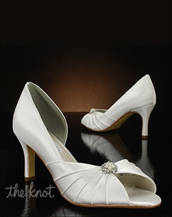 Open toe shoe features rhinestone and pearl brooch.