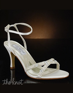 Strappy shoe features rhinestone and pearl details.