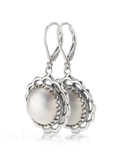 Sterling silver earrings feature 12mm white mabe pearls.