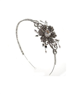 Rhodium-plated headband features Swarovski crystals and rhinestones.
