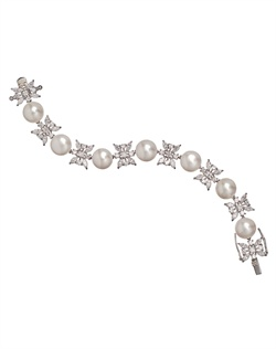 Bracelet features freshwater coin pearls and cubic zirconia. 7&quot; L