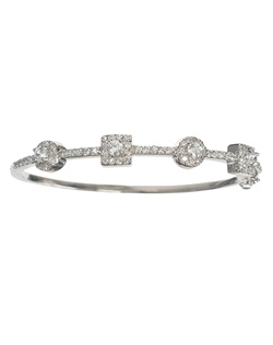 Rhodium-plated bracelet features cubic zirconia and hinge closure.