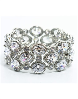 Rhodium-plated bracelet features cubic zirconia and hidden latch clasp. 7&quot; L