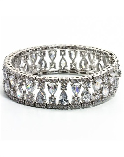 Rhodium-plated bracelet features crystals and hidden double latch clasp closure. 7&quot; L
