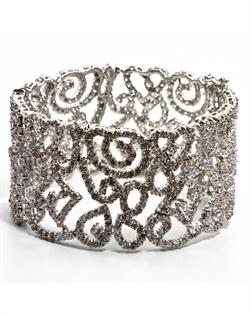 Rhodium-plated bracelet features cubic zirconia in swirl design. 7&quot; L