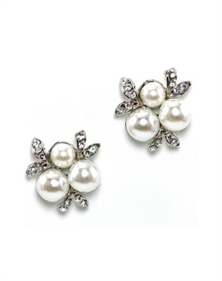 Earrings feature rhodium finish, crystals and faux pearls.