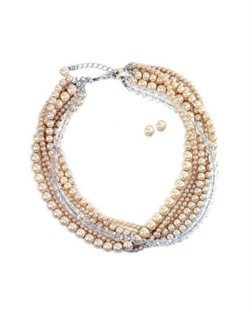 "Set features faux pearls and crystals. Necklace is 16"" - 18"""