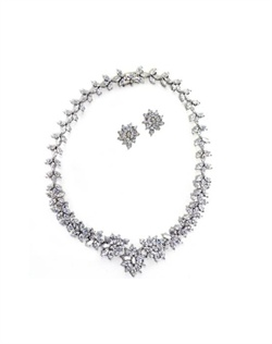 Set features rhodium finish and marquise cubic zirconia clusters.