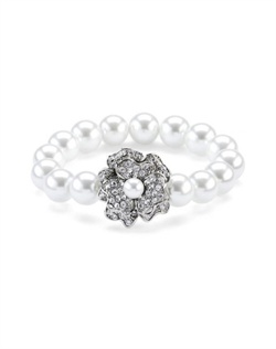 Bracelet features rhodium finish, crystals and 12mm faux pearls.