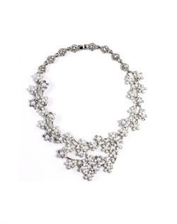 Necklace features rhodium finish, crystals and faux pearls.