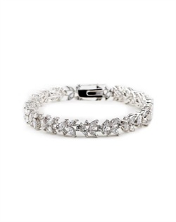 Rhodium-plated bracelet features cubic zirconia and hidden double latch clasp. 7&quot; L