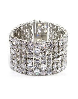 Bracelet features oval cubic zirconia and hidden double latch clasp. 7&quot; L