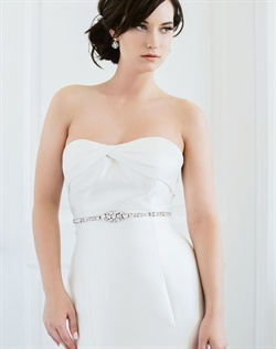 "Satin ribbon sash features Swarovski rhinestones. Available in diamond white, pale ivory or black. Rhinestones cover 19"" of sash, sash is 60 "" L"