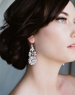 Rhodium filigree chandelier earrings feature Swarovski rhinestones.