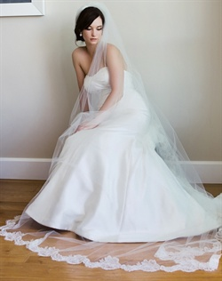 "Chapel-length veil features Alencon lace and tulle. Available in diamond white or pale ivory. 30""-145"" L"