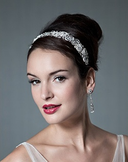 Headband features Swarovski crystals and rhinestones.