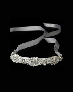 Features a vintage inspired ribbon headband.