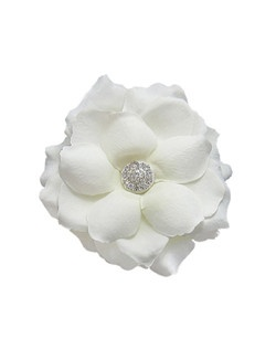 Features an open soft rose with a jeweled center.