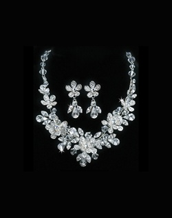 Featuring a floral design of Swarovski crystals and rhinestones.