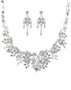 Features freshwater pearls and crystals in a handwired design.