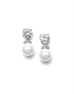 Features a classic design of cubic zirconia with pearl drops. Measures 3/4&quot;.