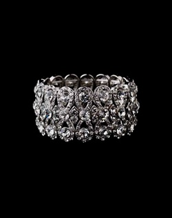 Features brilliant crystals in an intricate stretch bracelet design. Measures 11/2&quot; in width.