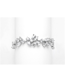"Features sparkling cubic zirconia stones ""dancing"" in shapes of marquise, pears and rounds. Bracelet measures 71/4"" in length."