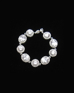 "Features cubic zirconia in a pave design. Measures 71/4""."