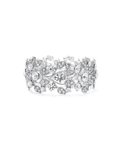 "Features sparkling crystals in a floral vine design. Measures 11/4"" in width."