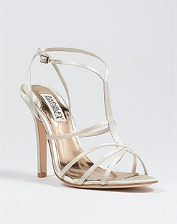 Strappy ivory wedding shoes.